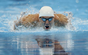 photo - Michael Phelps swims in the men's 200-meter individual medley preliminaries at the U.S. Olympic swimming trials on Friday, June 29, 2012, in Omaha, Neb. (AP Photo/Mark Humphrey) ORG XMIT: NEKS138