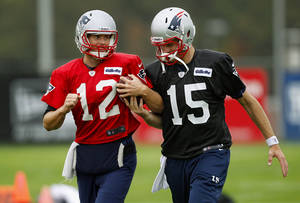 Photo -   New England Patriots quarterback Ryan Mallett (15) tries to pull the ball from starting quarterback Tom Brady's arm as they run next to each other during a drill at practice at the NFL football team's facility in Foxborough, Mass., Wednesday, Oct. 10, 2012. (AP Photo/Stephan Savoia)