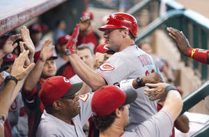 Photo -   Cincinnati Reds' Jay Bruce, center, is congratulated by teammates after hitting a three-run home run during the eighth inning of a baseball game against the Houston Astros, Sunday, Sept. 2, 2012, in Houston. (AP Photo/Dave Einsel)