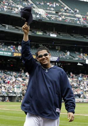 Photo - Seattle Mariners starting pitcher Felix Hernandez earned the AL Cy Young Award on Thursday. AP Photo