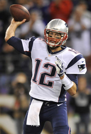 Photo -   New England Patriots quarterback Tom Brady throws to a receiver in the first half of an NFL football game against the Baltimore Ravens in Baltimore, Sunday, Sept. 23, 2012. (AP Photo/Gail Burton)