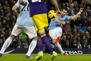 Photo - Manchester City's Alvaro Negredo, right, scores his team's first goal of the game against Swansea City during their English Premier League soccer match at the Etihad Stadium, Manchester, England, Sunday, Dec. 1, 2013. (AP Photo/Jon Super)