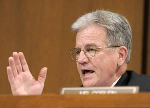 Photo - FILE - In this June 29, 2010 file photo, Sen. Tom Coburn, R-Okla., gestures on Capitol Hill in Washington.  Is anyone going to fix Social Security? Medicare? Medicaid? They're the big bills coming due.  While President Barack Obama and congressional leaders offer vague assurances, six senators _ three Republicans and three Democrats whose ideologies cover the entire liberal-conservative spectrum _ are quietly taking up the baton. (AP Photo/Susan Walsh, File) ORG XMIT: WX206