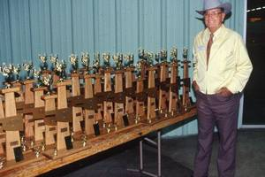 photo - Russell Pierson  is shown here in 1994 next to trophies for the National Land and Range Judging Contest in Oklahoma.  <strong>Provided - Photo provided</strong>