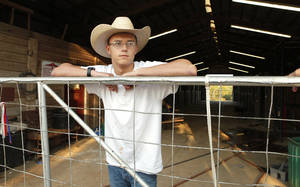 Photo - Resident John Cook, age 16, in the horse barn at Boys Town Ranch in Edmond Wednesday, Aug. 8, 2012.  Photo by Paul B. Southerland, The Oklahoman