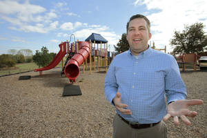 photo - Craig Dishman, Edmond's new parks and recreation direction, stands in the J.L. Mitch Park playground, something he would like to refurbish. PHOTO BY DAVID MCDANIEL, THE OKLAHOMAN