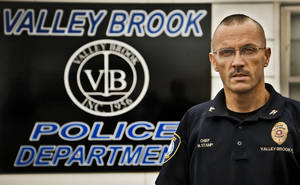 Photo - Valley Brook police chief Michael Stamp poses for a photo at the police station in Valley Brook. <strong>CHRIS LANDSBERGER - The Oklahoman</strong>