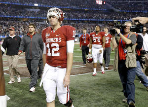 Photo - Oklahoma's Landry Jones (12) walks off the field after the Cotton Bowl college football game between the University of Oklahoma (OU)and Texas A&M University at Cowboys Stadium in Arlington, Texas, Friday, Jan. 4, 2013. Oklahoma lost 41-13. Photo by Bryan Terry, The Oklahoman