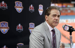 Photo - Alabama head coach Nick Saban answers a question during Media Day for the BCS National Championship college football game Saturday, Jan. 5, 2013, in Miami. Alabama faces Notre Dame in Monday's championship game. (AP Photo/Chris O'Meara)