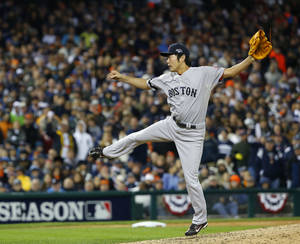 Photo - Boston Red Sox's Koji Uehara throws in the eighth inning during Game 5 of the American League baseball championship series against the Detroit Tigers, Thursday, Oct. 17, 2013, in Detroit. (AP Photo/Paul Sancya)