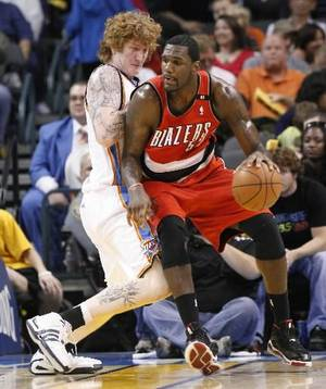 Photo - Portland's Greg Oden drives the ball against Oklahoma City's Robert Swift during the NBA basketball game between the Oklahoma City Thunder and the Portland Trail Blazers at the Ford Center in Oklahoma City, Friday, April 3, 2009. Photo by Bryan Terry, The Oklahoman