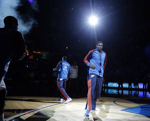Photo - Oklahoma City's Kevin Durant (35) is introduced before an NBA basketball game between the Oklahoma City Thunder and the Toronto Raptors at Chesapeake Energy Arena in Oklahoma City, Sunday, Dec. 22, 2013. Oklahoma City won 107-95. Photo by Sarah Phipps, The Oklahoman