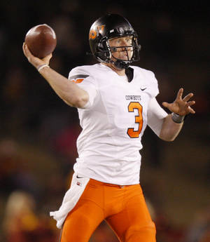 Photo - Oklahoma State's Brandon Weeden (3) throws a pass during a college football game between the Oklahoma State University Cowboys (OSU) and the Iowa State University Cyclones (ISU) at Jack Trice Stadium in Ames, Iowa, Friday, Nov. 18, 2011. Photo by Bryan Terry, The Oklahoman