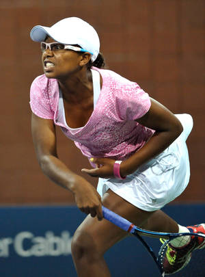 Photo - Victoria Duval of the United States serves against Daniela Hantuchova of Slovakia during their first set at the U.S. Open Tennis tournament on Thursday, Aug. 29, 2013 in New York. (AP Photo/Kathy Kmonicek)