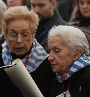 Photo - Former prisoners  of the Auschwitz concentration camp attend  a ceremony  in Oswiecim, Poland, Sunday, Jan. 27, 2013, marking the 68th anniversary of the liberation of Auschwitz by Soviet troops and  remembering the victims of the Holocaust, in Auschwitz-Birkenau.  (AP Photo/Czarek Sokolowski)