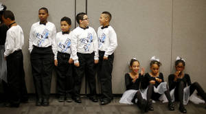 photo - Dancers from Tulakes Elementary School rest backstage before performing at a dance competition at the Rose State Performing Arts Theatre in Midwest City. Photo by Bryan Terry, The Oklahoman <strong>BRYAN TERRY - THE OKLAHOMAN</strong>