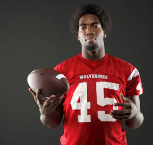 photo - HIGH SCHOOL FOOTBALL: All-State football player D.J. Ward, of Lawton, poses for a photo in Oklahoma CIty, Wednesday, Dec. 14, 2011. Photo by Bryan Terry, The Oklahoman