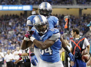 Photo - Detroit Lions wide receiver Ryan Broyles (84) celebrates his touchdown with wide receiver Calvin Johnson in the first half of an NFL football game, Sunday, Oct. 28, 2012. in Detroit. (AP Photo/Rick Osentoski) ORG XMIT: DTF112