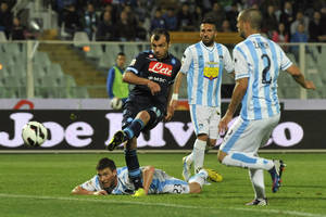 Photo - Napoli Macedonian forward Goran Pandev scores his side's second goal during a Serie A soccer match between Pescara and Napoli, at the Adriatico stadium in Pescara, Italy, Saturday, April 27, 2013. (AP Photo/Sandro Perozzi)