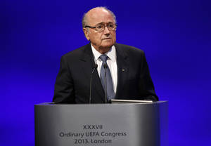 Photo - FIFA President Joseph S. Blatter addresses the delegates during the 37th Ordinary UEFA Congress in London, Friday, May 24, 2013. (AP Photo/Sang Tan)