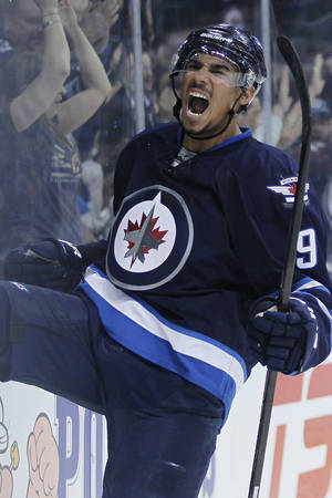 Photo - Winnipeg Jets' Evander Kane (9) celebrates his goal against the Colorado Avalanche during second period NHL action in Winnipeg on Wednesday, March 19, 2014. THE CANADIAN PRESS/John Woodsduring the second period of an NHL hockey game Wednesday, March 19, 2014, in Winnipeg, Manitoba. (AP Photo/The Canadian Press, John Woods)