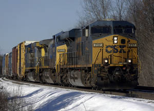 Photo - FILE - In this Friday, Jan. 18, 2013, file photo, a CSX train passes through New Scotland, N.Y.  CSX warned Thursday, Jan. 16, 2015, that it will be more difficult to reach its own profit targets for double-digit growth over the next two years because of ongoing weakness in demand for coal and because last year's results included several large, but one-time benefits. (AP Photo/Mike Groll, File)