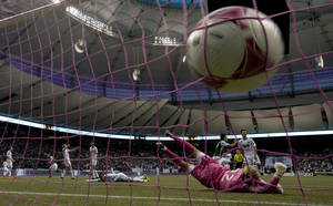 Photo - Portland Timbers Will Johnson's shot goes past Vancouver Whitecaps FC goalkeep David Ousted during the second half of MLS soccer action in Vancouver, British Columbia, Sunday, Oct. 6, 2013. (AP Photo/The Canadian Press, Jonathan Hayward)