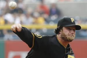 Photo - Pittsburgh Pirates' Gerrit Cole (45) throws against the San Francisco Giants in the first inning of a baseball game on Wednesday, May 7, 2014, in Pittsburgh.  (AP Photo/Keith Srakocic)