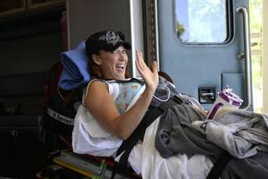 "Photo - ENGLEWOOD, CO - JUNE 18: Amy Van Dyken-Rouen waves as she arrives at Craig Hospital after leaving Scottsdale Healthcare Osborne Medical Center June 18, 2014 by Angel MedFlight. Amy will join approximately 40 other inpatients with her type of injury from around the U.S. currently undergoing the specialized SCI rehabilitation at Craig. Amy will have a SCI ""Interdisciplinary"" Team, a physician, rehab nurses and rehab nurse technicians, physical therapist, occupational therapist, clinical psychologist, therapeutic recreation specialist, dietician, clinical care manager, and others. (Photo by John Leyba/The Denver Post)"