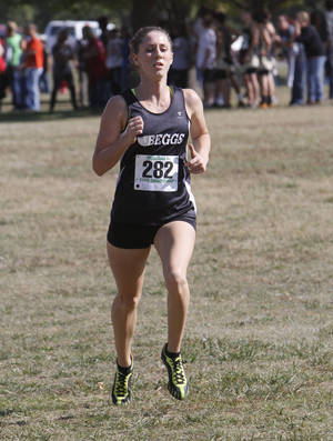 photo - Beggs&#039; Regan Ward approaches the finish line to take third place during the girls class 3A State Cross Country meet at Gordon Cooper Vo-Tech in Shawnee, OK, Saturday, Oct. 22, 2011. Photo By Paul Hellstern, The Oklahoman Archives
