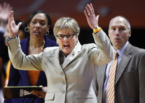 Photo - Tennessee head coach Holly Warlick, foreground, reacts to a call in the second half of an NCAA college basketball game against South Carolina, Sunday, March 2, 2014, in Knoxville, Tenn. Tennessee won 73-61. (AP Photo/Wade Payne)