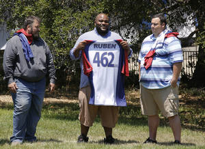 "Photo - This image released by NBC shows, from left, David Brown, Ruben Studdard, and Hap Holmstead on ""The Biggest Loser,"" in Calbasas, Calif.  Studdard, the season two winner of ""American Idol"" is the 15th season's heaviest contestant at 462 pounds. ""The Biggest Loser"" returns Oct. 8 at 8 p.m on NBC. (AP Photo/NBC, Trae Patton/NBC)"