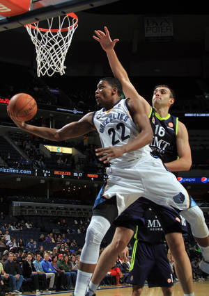 Photo -   Memphis Grizzlies forward Rudy Gay (22) shoots while defended by Real Madrid center Mirza Begic (16) in the first half of an NBA basketball preseason game on Saturday, Oct. 6, 2012, in Memphis, Tenn. (AP Photo/Nikki Boertman)