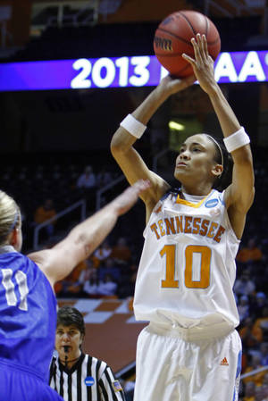 Photo - Tennessee guard Meighan Simmons (10) shoots over Creighton guard McKenzie Fujan (11) in the second half of a second-round game in the women's NCAA college basketball tournament on Monday, March 25, 2013, in Knoxville, Tenn. Tennessee won 68-52 to advance. (AP Photo/Wade Payne)