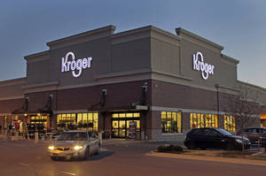 Photo - FILE - This June 12, 2012 file photo shows a Kroger store in Indianapolis. The Kroger Co. reports quarterly earnings on Thursday, March 6, 2014. (AP Photo/Michael Conroy, File)