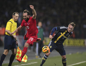 Photo - Turkey's Olcan Adin, left, vies for the ball with Sweden's Pierre Bengtsson during their International Friendly soccer match at 19 Mayis Stadium in Ankara, Turkey, Wednesday, March 5, 2014. (AP Photo)
