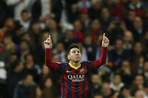 Photo - Barcelona's Lionel Messi from Argentina, left, celebrates his goal  during a Spanish La Liga soccer match between Real Madrid and FC Barcelona at the Santiago Bernabeu  stadium in Madrid, Spain, Sunday, March 23, 2014. (AP Photo/Andres Kudacki)