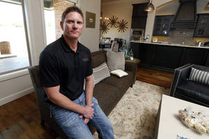 Photo -  Richard Foster of Foster Signature Homes is shown in a home he had in the Parade of Homes Spring Festival on Cordova Court in Norman's Las Colinas addition. Builders say traffic and sales during the two-weekend event were high.  PHOTO BY STEVE SISNEY, THE OKLAHOMAN  <strong>STEVE SISNEY -  THE OKLAHOMAN </strong>