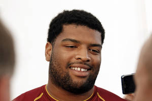 Photo - FILE - This Aug. 2, 2012 file photo shows Washington Redskins offensive tackle Trent Williams smiling as he speaks during a media availability after practice at NFL football training camp at Redskins Park in Ashburn, Va. A year ago, Williams' four-game suspension put him on the list of Redskins who were contributing to a losing culture. He has since worked tirelessly to rehabilitate himself on and off the field to and get himself off that list, playing through pain for a team that's now winning. (AP Photo/Alex Brandon, File) ORG XMIT: NY162