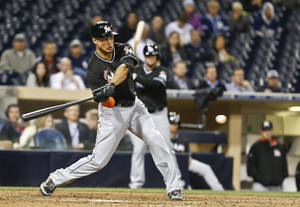 Photo - Miami Marlins' Giancarlo Stanton connects for his 11th home run of the season in the 11th inning against the San Diego Padres in  a baseball game Thursday, May 8, 2014, in San Diego. The two-run homer came after a two out error by Padres' second baseman Jedd Gyorko. (AP Photo/Lenny Ignelzi)