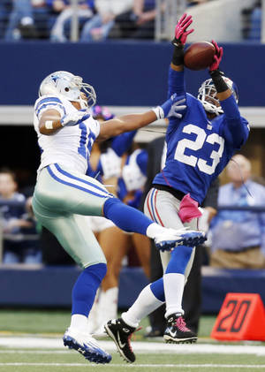 Photo -   New York Giants cornerback Corey Webster (23) intercepts a pass from Dallas Cowboys quarterback Tony Romo intended for wide receiver Miles Austin (19) during the first half of an NFL football game Sunday, Oct. 28, 2012 in Arlington, Texas. (AP Photo/Sharon Ellman)