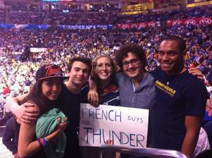 Photo - French students Carla Deroual Urbani, Jules Andreau and Louis David pose with Harding Charter Prep students, Angela Thompson-Butler and Alistair Connell at the April 15 Oklahoma City Thunder game at the Chesapeake Arena. PHOTO PROVIDED