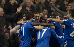Photo - Chelsea's Samuel Eto'o left, celebrates with teammates after scoring against shoots Tottenham Hotspur, during their English Premier League soccer match, at the Stamford Bridge Stadium in London, Saturday, March 8, 2014. (AP Photo/Bogdan Maran)