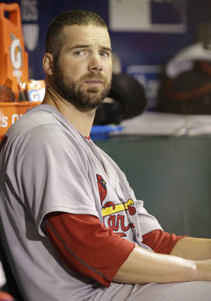 photo - FILE - In this Oct. 15, 2012, file photo, St. Louis Cardinals starting pitcher Chris Carpenter sits in the dugout after being taken out of the game during the fifth inning of Game 2 of baseball's National League championship series against the San Francisco Giants in San Francisco. Carpenter is unlikely to pitch for the Cardinals this season and his career may be over because of a nerve injury that kept him out most of last year, general manager John Mozeliak said Tuesday, Feb. 5, 2013. (AP Photo/David J. Phillip, File) ORG XMIT: NY158