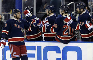 Photo - New York Rangers right wing Marian Gaborik (10) celebrates with teammates after he scored one of two goals in the first period of their NHL hockey game at Madison Square Garden in New York, Wednesday, Jan. 23, 2013.  (AP Photo/Kathy Willens)
