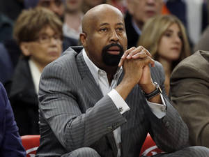 Photo - New York Knicks head coach Mike Woodson watches his team play during the first half of an NBA basketball game against the Toronto Raptors Wednesday, April 16, 2014, in New York. (AP Photo/Frank Franklin II)