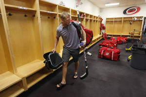 Photo -   Carolina Hurricanes' Jordan Staal leaves the locker room after the NHL hockey team's informal workout at Raleigh Center Ice on Friday, Sept. 14, 2012, in Raleigh, N.C. Staal was taking his gear, which is normally stored in the lockers, with him as the players will not be allowed to use the facility in the event of an NHL lockout. (AP Photo/The News & Observer, Ethan Hyman) MANDATORY CREDIT