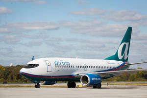 Photo - An AirTran Airways plane, which will begin flying out of Will Rogers World Airport this fall. <strong> - PROVIDED</strong>