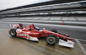 Photo - Scott Dixon, of New Zealand, pulls out of the pits during qualifications for the inaugural Grand Prix of Indianapolis IndyCar auto race at the Indianapolis Motor Speedway in Indianapolis, Friday, May 9, 2014. (AP Photo/Darron Cummings)