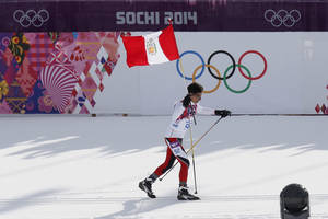 Photo - Peru's Roberto Carcelen skis with the Peruvian flag during the men's 15K classical-style cross-country race at the 2014 Winter Olympics, Friday, Feb. 14, 2014, in Krasnaya Polyana, Russia. (AP Photo/Dmitry Lovetsky)